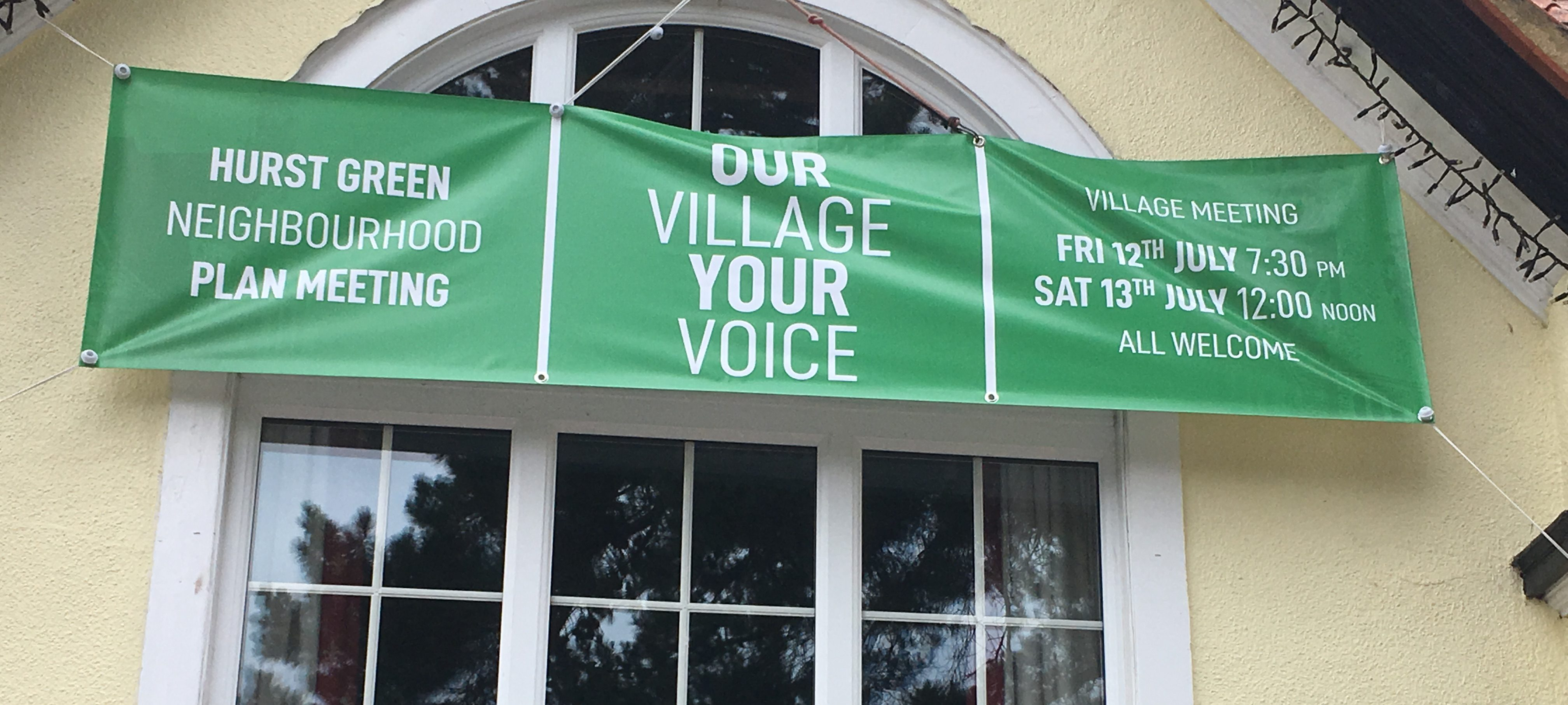 image of banner on the village hall promoting the neighbourhood plan